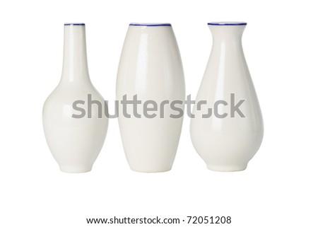 Chinese porcelain vases of various shapes on white background - stock photo