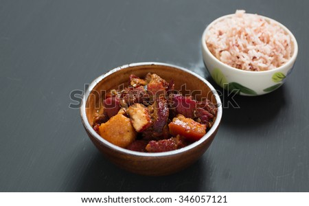 Chinese pork belly caramelized and braised in soy sauce with star anise, cinnamon and chilies. eat with rice - stock photo