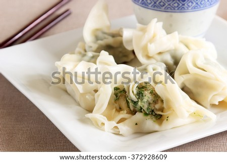 Chinese raviolis to serve as a side dish or entrée during the New Year - stock photo