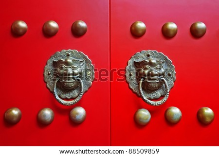 Chinese red gate doors with lion door knob, Forbidden City , Beijing - stock photo
