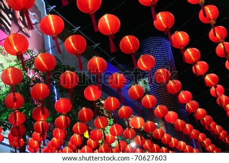 Chinese red paper lanterns at night . It was decorated the mall somewhere in Bangkok at night during Chinese New Year. - stock photo