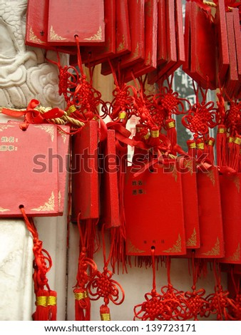 chinese red wishes tablets hanged in a temple of shanghai