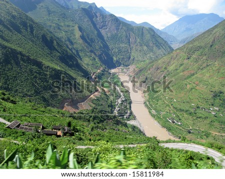 Chinese river in Yunnan province, going to Lugu Lake - stock photo