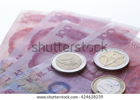 Chinese RMB bills and coins - stock photo