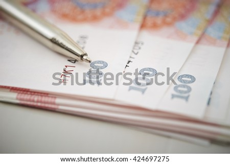 Chinese RMB bills and pen