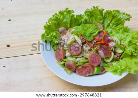 Chinese Sausage Salad on wood background