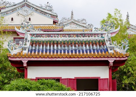 Chinese sculpture which decorate on a roof of Chinese temple - stock photo