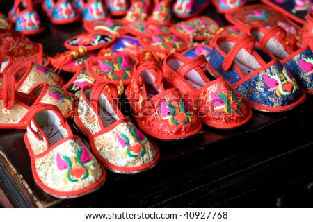 Chinese shoes embroidered with flowers, for child - stock photo