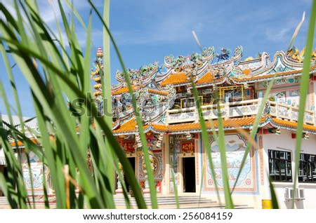 Chinese Shrine The roof is decorated with dragon sculpture - stock photo