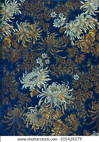Chinese silk with flower motive. Chrysanthemums. - stock photo