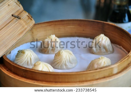 Chinese soup dumplings in a steamer, 6 pieces - stock photo