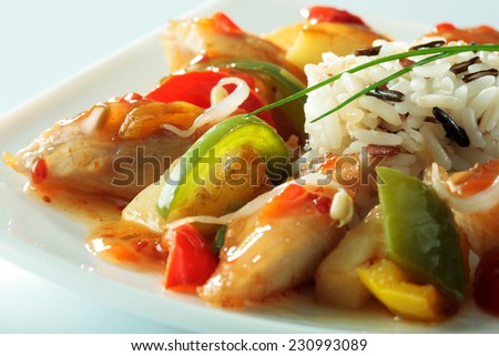 Chinese specialty with chicken, rice, vegetables and soybean sprouts close-up on white plate  - stock photo