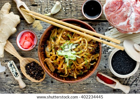 Chinese spicy dish udon noodles with meat sauce and vegetables top view - stock photo