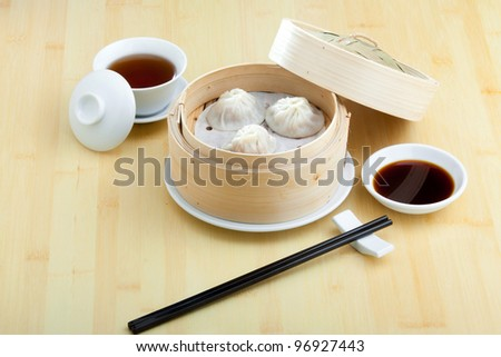 Chinese steamed dimsum in bamboo containers traditional cuisine - stock photo