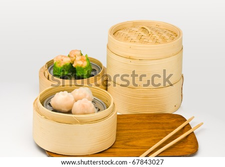 Chinese steamed dimsum in bamboo containers traditional cuisine gray background - stock photo