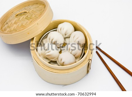 Chinese Steamed shrimp dumplings dimsum  in bamboo containers traditional cuisine - stock photo