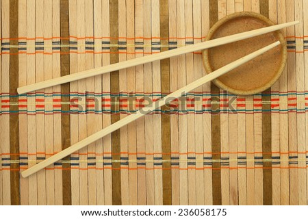 Chinese sticks from a bamboo for a meal on the wattled mat