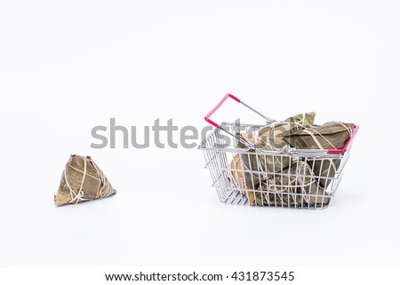 Chinese sticky rice dumplings (zongzi) in a wire shopping basket isolated with white background, made of rice and bamboo leaf, ussually eaten during Dragon boat festival - stock photo