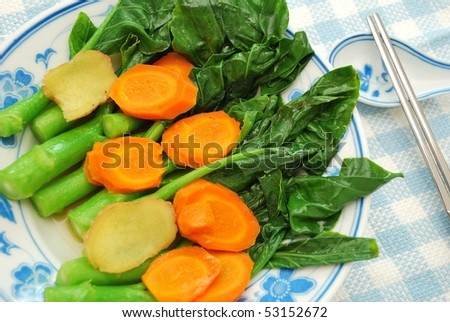 Chinese stir fried healthy Kai Lan vegetables. Commonly eaten in Cantonese cuisine. Suitable for food and beverage, healthy eating and diet and nutrition concepts.