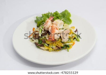 chinese stir-fried noodles in plate on white background