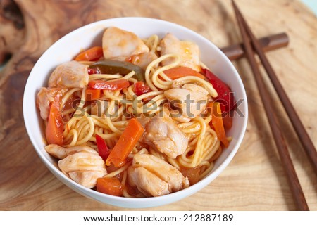 chinese stir fried noodles with a chicken - stock photo