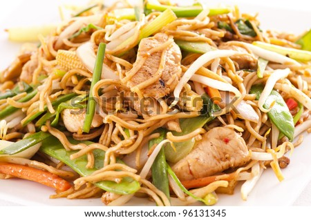 chinese stir fried noodles with chicken - stock photo