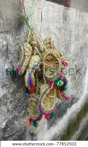 Chinese straw shoes - stock photo