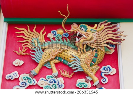 Chinese style gold dragon statue at roof temple , dragon-headed  - stock photo