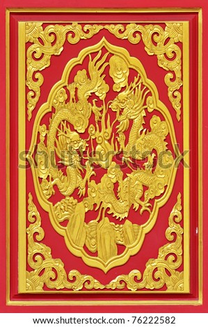 chinese style golden dragon on the red wood door.