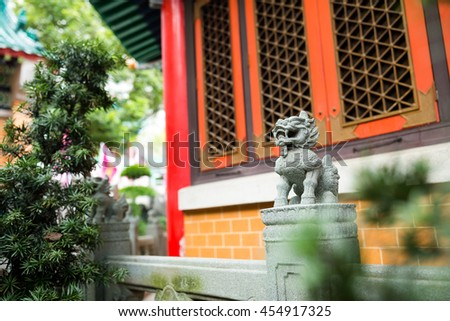 Chinese style granite rock carved lion statue  - stock photo