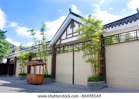 Chinese style house with green bamboo - stock photo