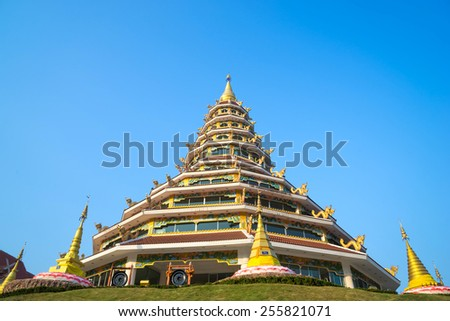 Chinese style nine level pagoda in Thai temple under blue sky - stock photo