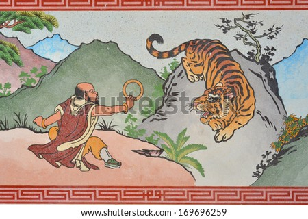 Chinese style painting on wall of shrine in Thailand - stock photo