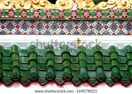 Chinese style pattern on the roof in Thailand - stock photo