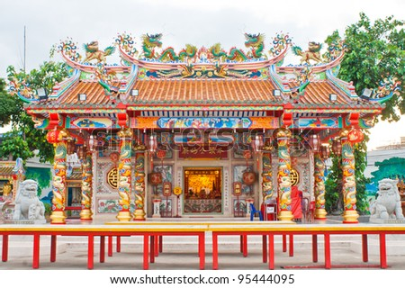Chinese style pavilion and dragon statue - stock photo