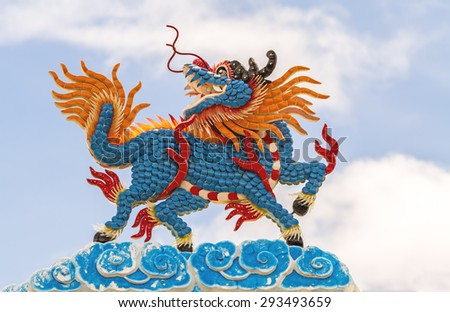 Chinese style roof decoration and blue sky  in Chinese temple,Thailand ( Generality in Thailand ,and kind of art decorated in Buddhist church, temple pavilion ,temple hall . They are public) - stock photo