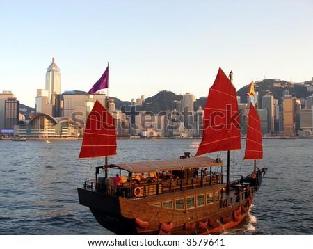 Chinese-style sailboat sailing in the Hong Kong harbor - stock photo