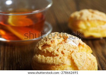 Chinese sweet dessert with tea on the table - stock photo