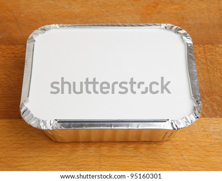 Chinese takeaway food in foil tray - stock photo