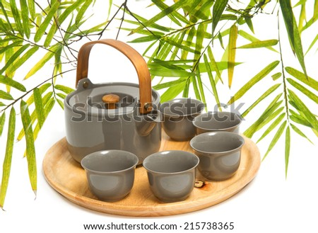 Chinese tea ceremony on bamboo leaf  background
