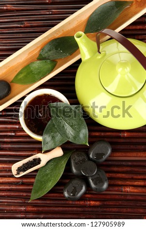 Chinese tea ceremony on bamboo table close-up - stock photo