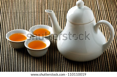 Chinese Tea on Bamboo Tablemat - stock photo