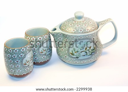 Chinese tea pot and tea cups - stock photo