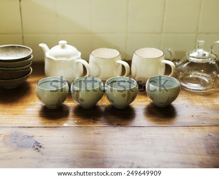 Chinese tea set of teapot and cups on table - stock photo