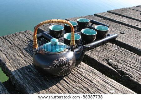 Chinese tea set on a wooden jetty - stock photo