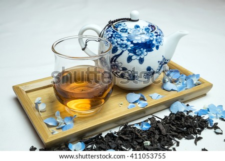 Chinese tea set with tea and flowers - stock photo