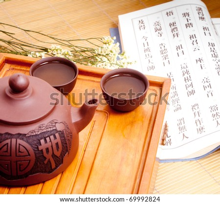 Chinese tea with vintage book - stock photo