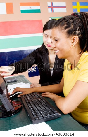 chinese teacher teaching in classroom - stock photo