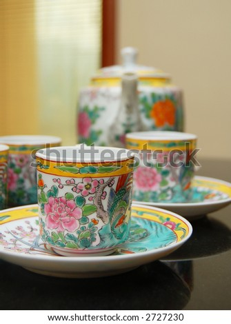 chinese teacups and pot - stock photo