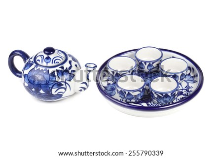 Chinese teapot and tea cup on a white background - stock photo